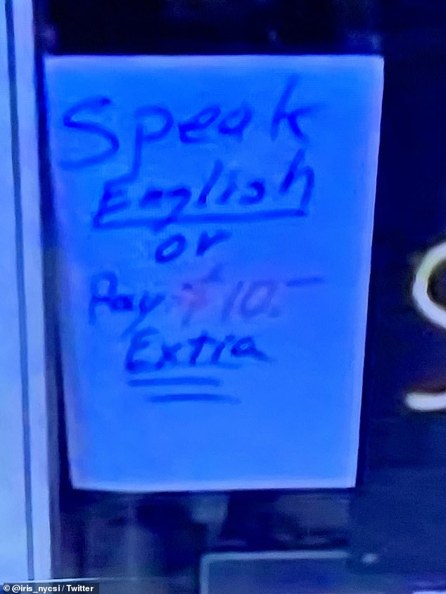 The sign read 'Speak English or Pay $10 extra' and was hung in the store's window about three weeks ago  (pictured)