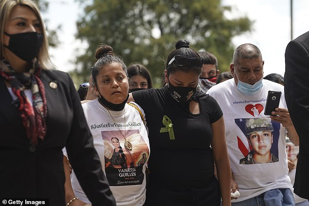 """'My daughter didn't give me a name. But I begged Vanessa's friend so much…and she said, """"Yes, yes, there is a man: Robinson,""""' Gloria Guillen, Guillen's mother, said to 20/20. Gloria pictured center at her daughter's memorial service on August 14 in her hometown of Houston, Texas"""