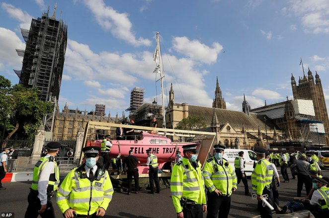 The XR protesters brought their bright pink boat back to the city on the final day of their two-week long demonstration