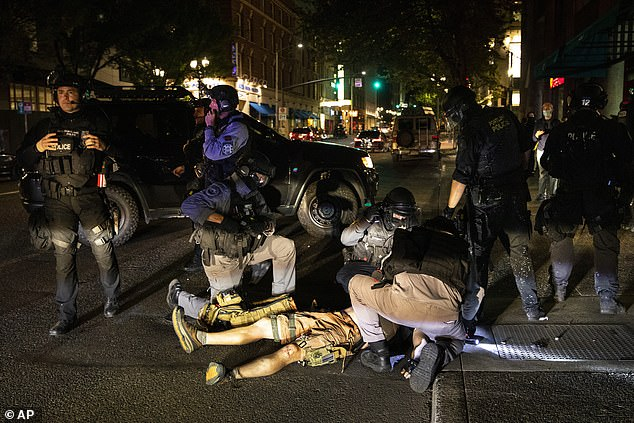 Medics attend to Danielson after he was shot in downtown Portland last month on August 29th