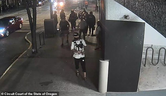 Surveillance images show Reinoehl (front) walking in front of Aaron 'Jay' Danielson (behind him left in black shirt) moments before Danielson was shot dead in Portland on Saturday