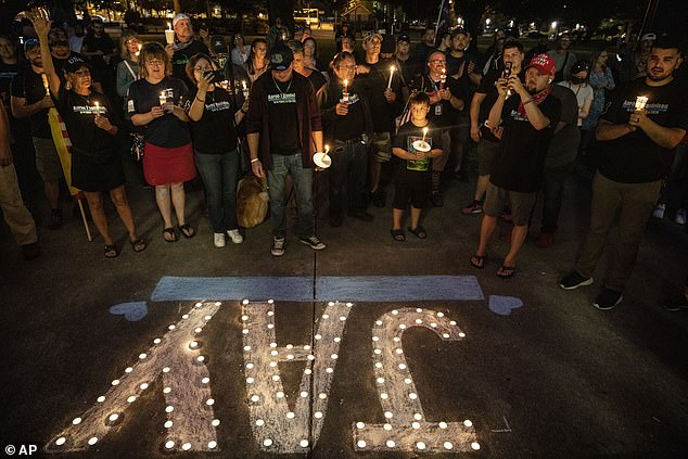People hold candles during a vigil September 5 in Washington for Danielson