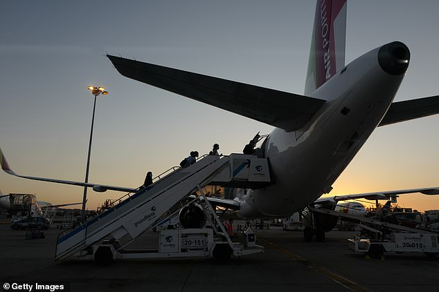 Passengers are seen boarding a flight from Portugal to Britain on September 3rd. Tens of thousands of British holidaymakers are facing a race to escape Portugal after the country was returned to the quarantine list