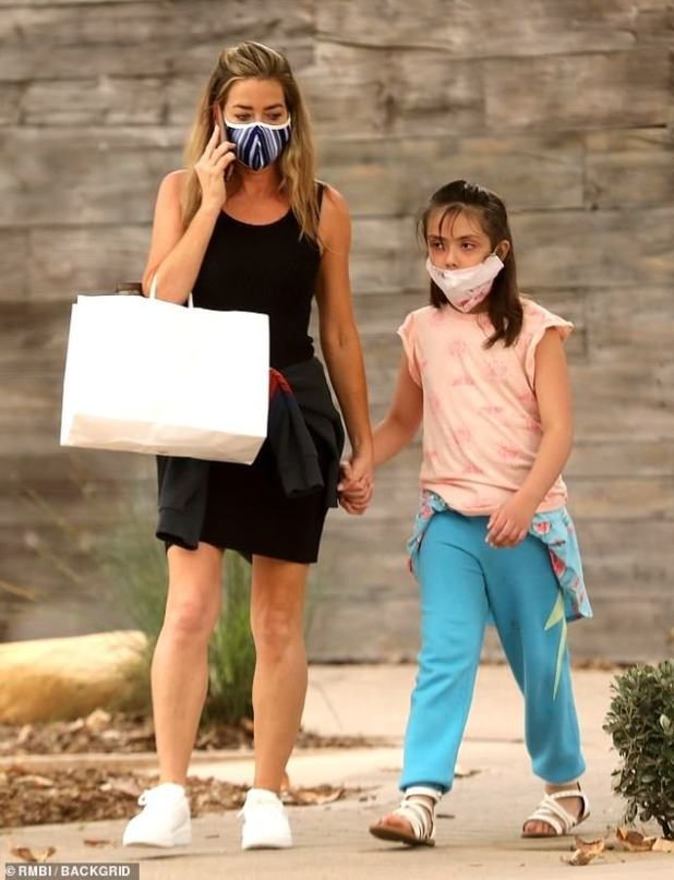 Support system: Richards, who joined the RHOBH cast in season nine, was accompanied by her daughter Eloise Joni, nine, as she met in some retail therapy