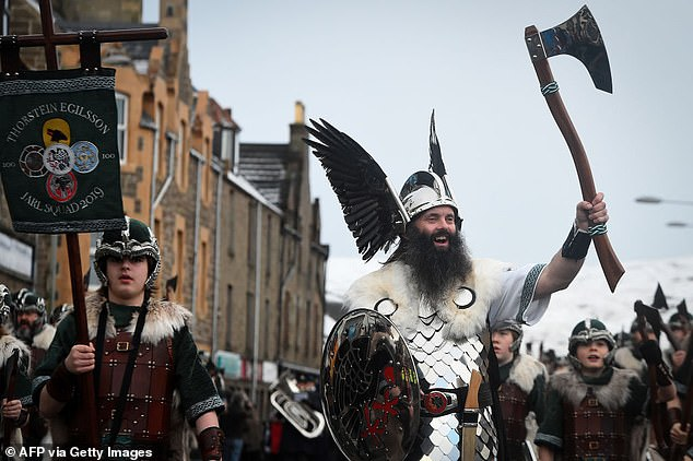 Councillors voted 18 to two in favour of a motion to formally explore options 'for achieving financial and political self-determination'. Pictured: Attendees at Shetland's Up Helly Aa fire festival