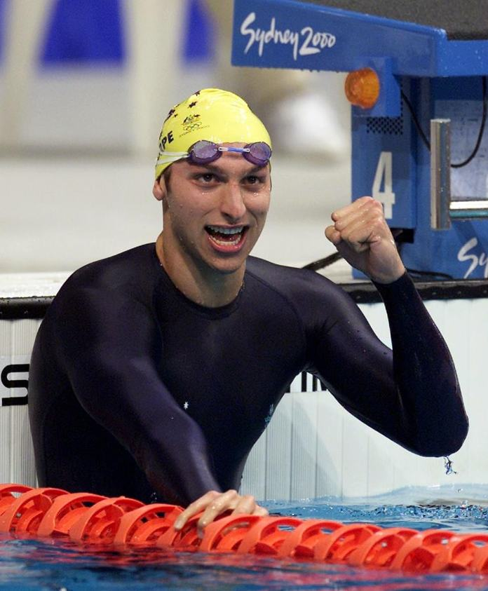 Australia's Ian Thorpe (pictured) celebrates after setting a new world record to win the gold medal in the 400m men's freestyle swimming at the Sydney 2000 Olympic Games
