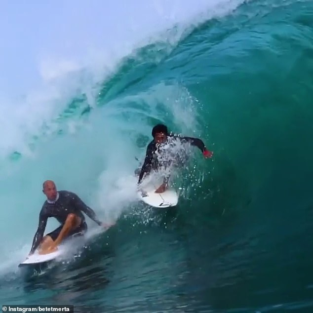 The pair shared incredible footage of themselves riding massive waves on a near empty beach in Bali