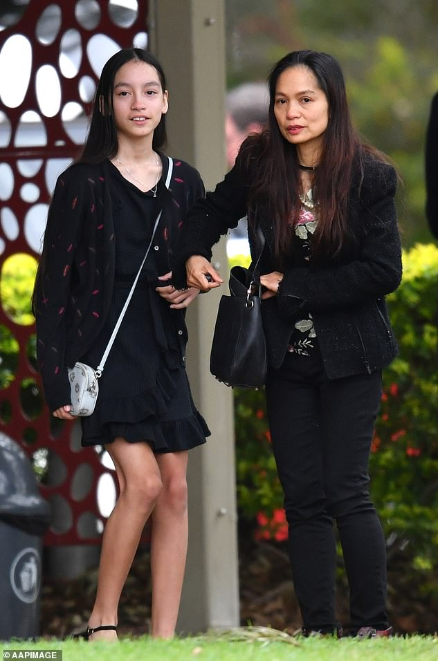 Ms Caisip was also barred from talking to her sister as she arrived at the Mount Gravatt cemetery - 20 minutes after the funeral finished. Pictured: Hersister Isobel Prendergast, 11, and mother Myrna Prendergast