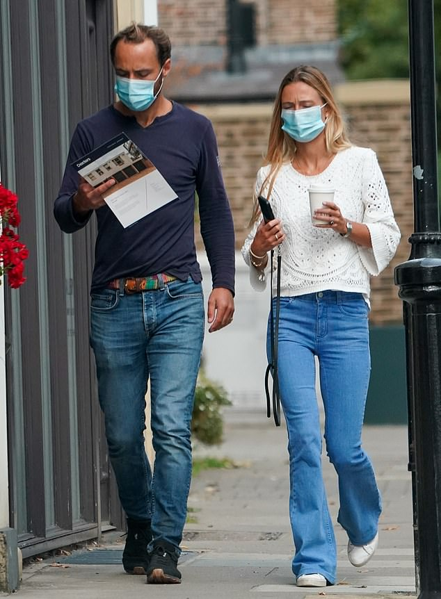 Safety first: The couple both wore face masks while strolling through London today (pictured)
