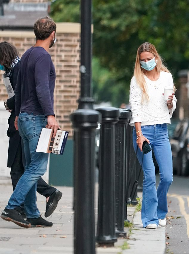 Lots to discuss: The couple looked casual for their viewing in south-west London today
