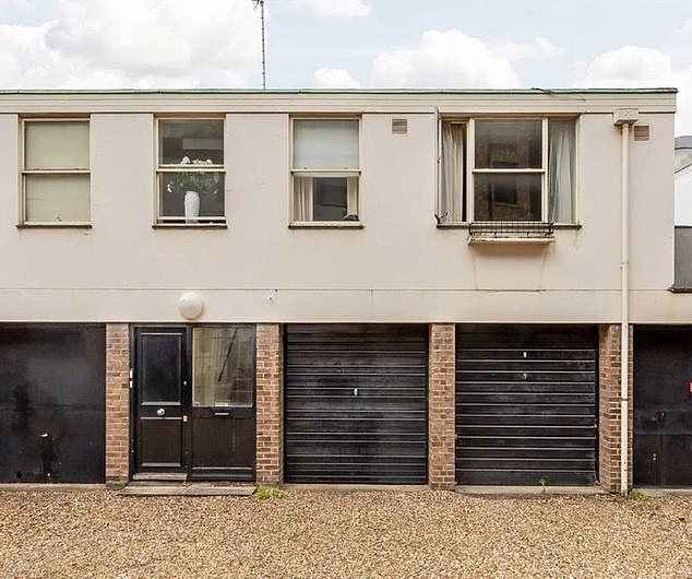 Low key:The property (pictured) boasts its own terrace and three garages - a rarity for central London - but is otherwise far more modest than one might expect