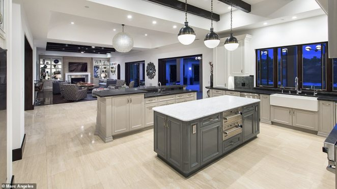 In the heart of the home is the chef¿s kitchen with stainless steel appliances and two islands that flow seamlessly into the great room