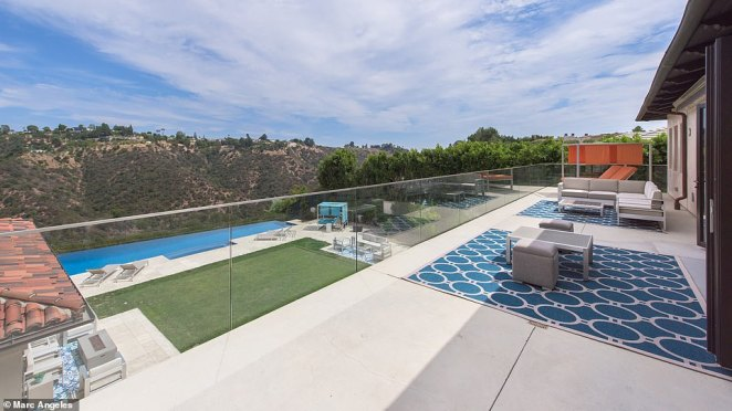 The view from Griffin's master bedroom puts the stunning California mountains on display through glass doors that open to the 1,100sqft private balcony