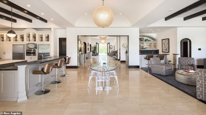 According to the property listing by Josh and Matt Altman of Douglas Elliman, 'The moment you enter the grand front doors, the sheer scale and brightness of the home will take your breath away'