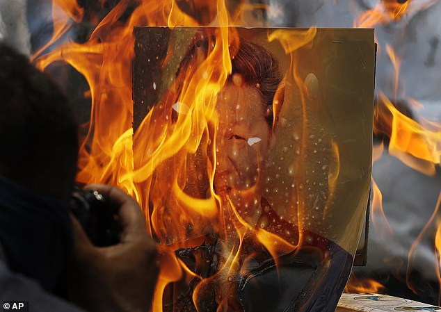 Indian traders burn Chinese products and a poster of China's president Xi Jinping during a protest in New Delhi, India.Since last week, the Asian giants have accused each other of sending soldiers into rival territory and firing warning shots for the first time in 45 years