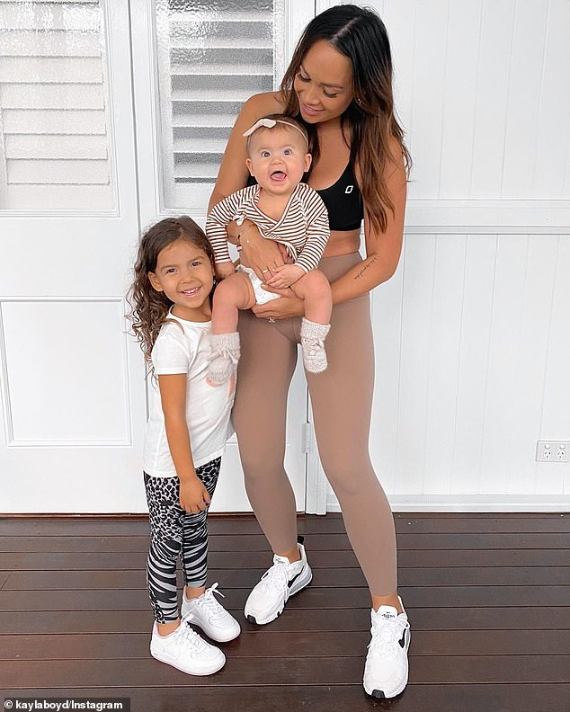 Kayla Boyd (pictured with her daughters), 32, shared the joyous news with her followers on Instagram on Friday