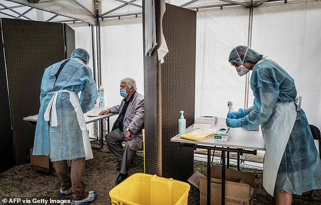 Medical staff with protective gear conduct tests for Covid-19, today in Venissieux, near Lyon, amid the novel coronavirus pandemic