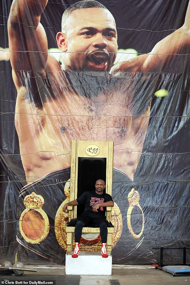 Jones is a four division champion and widely considered to be the best pound for pound boxer in history. He's pictured sitting on his throne at his gym in front of a huge photo of him in his prime