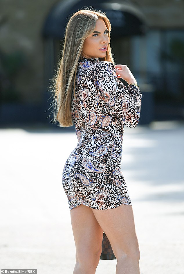 Smokin': elsey Stratford displayed her slender legs in a paisley and leopard print mini dress