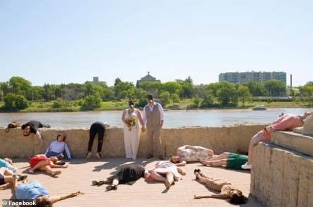 Controversial: A bride and groom have sparked fury online after posing for wedding pictures that appear to 'make fun' of the pandemic by having the guests play dead on the ground