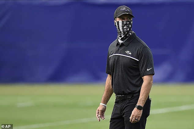 Ravens coach John Harbaugh said he will forgo the face shield after seeing Reid's struggles