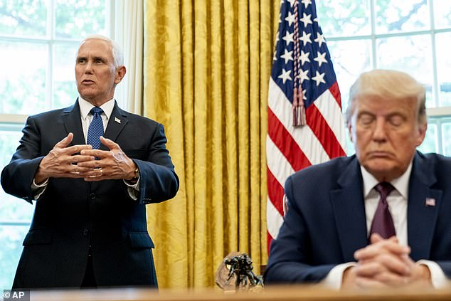 Vice President Mike Pence, left, accompanied by President Donald Trump, speaks in the Oval Office of the White House, Friday, Sept. 11, 2020, in Washington. Trump has previously challenged Biden to take a drug test. He made a similar challenge to rival Hillary Clinton in 2016