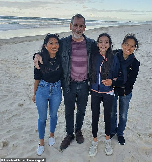 Sarah Caisipis pictured with her father Bernard Prendergast, 11-year-old sister Isobel Prendergast and mother Myrna Prendergast. The 26-year-old was denied a quarantine exemption from the Queensland government to attend her father's funeral in Brisbane on Thursday