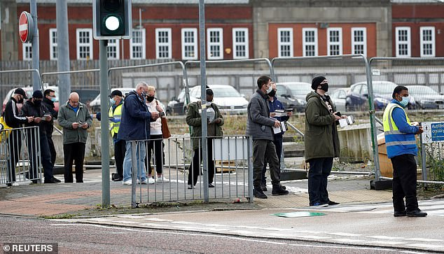 People queue to undertake a coronavirus disease (COVID-19) test at a walk-in test facility in Bolton, Britain last week