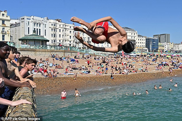 Temperatures in southern England could reach 29C (84F) on Monday and rise as high as 31C (88F) by Tuesday. A man jumps from the jetty into the sea in Brighton, on the south coast of England, amid an earlier heatwave in August