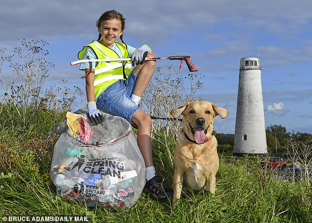 Elizabeth Gadson, 9, and her Labrador Banjo were also involved in the clean up in Merseyside