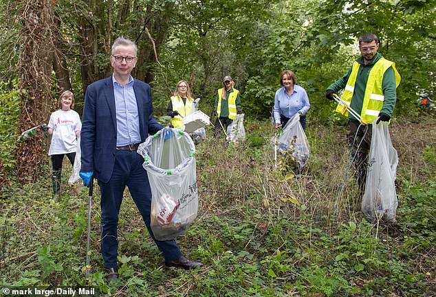 Cabinet Minister Michael Gove, pictured, joined thousands of volunteers across the country as part of the Daily Mail's Great British September Clean