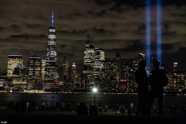 Tribute to the Light, two vertical columns of light representing the fallen towers of the World Trade Center shine against the lower Manhattan horizon, as seen from Jersey City, New Jersey