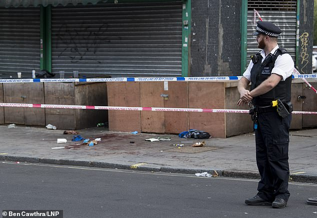 Police have set up a crime scene on Harrow Road, London, after a woman in her 30s was shot at 11.50pm yesterday