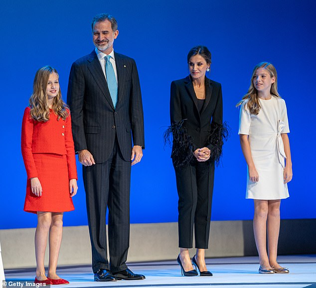 Despite their daughters quarantining for 14 days, King Felipe and Queen Letizia will continue to perform royal duties (pictured, together in November 2019)