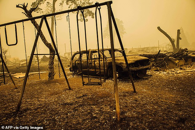 A charred swing set and car are seen after the passage of the Santiam Fire in Gates, Oregon, Thursday.Oregon officials are bracing for a 'mass fatality event'