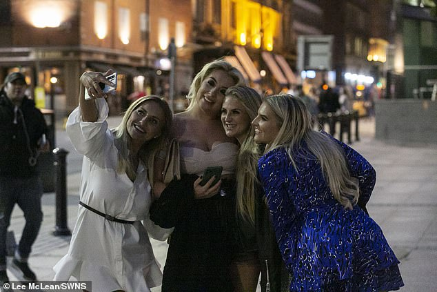 Four girls pose for a selfie as they head into Manchester city centre for a final weekend of freedom before the 'rule of six' hits on Monday