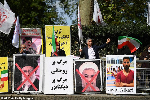 LONDON:Protesters wave the Lion and Sun flag of the National Council of Resistance of Iran and the white flag of the People's Mujahedin of Iran, two Iranian opposition groups, outside the Iranian embassy in London, protesting the execution ofNavid Afkari