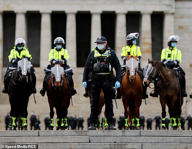 The figure follows police (pictured) arresting 14 anti-lockdown protesters after swarming the streets of Melbourne in a bid to shut down a 'Freedom Walk' rally