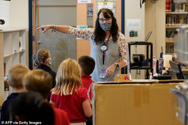 School districts and state officials have struggled to find the right balance with coronovirus precautions with some schools already being forced to learn online within the first week of returning to classrooms.  Stock image