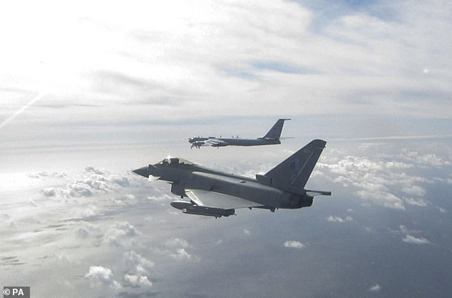 Handout photo dated today issued by the MoD showing a Eurofighter Typhoon (near) and a Russian Bear F aircraft (far), one of two Russian aircraft the Typhoon has been sent to intercept off the Scottish Coast