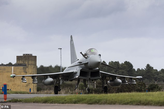 Handout photo dated today issued by the MoD showing a Eurofighter Typhoon landing at Leuchars Station after returning from a Quick Reaction Alert to intercept two Russian aircraft off the Scottish Coast