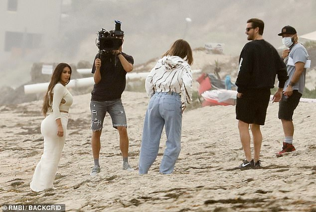 Toxic air: But it was hardly an ideal beach day for the Kardashian clan what with the smoke-filled clouds from the devastation of the Western wildfires blotting out the sun