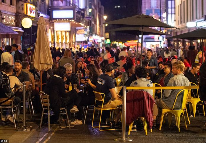 "LONDON: General view of people enjoying a night out in Soho, in London's West End. People have been warned against having a ""party weekend"" as a former chief scientific adviser said the UK is ""on the edge of losing control"" of coronavirus"