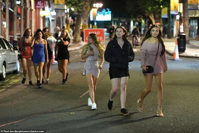 Hundreds of people enjoyed a Saturday night on the town in the pubs and bars in Guildhall Walk in Portsmouth, Hampshire. Many were in groups of more than six people which will be banned from Monday