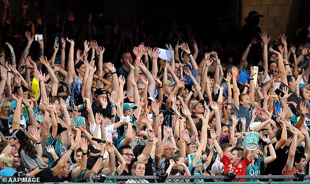 Spectators cheer at the Gabba in Brisbane during a match between the Brisbane Heat and the Sydney Sixers in January
