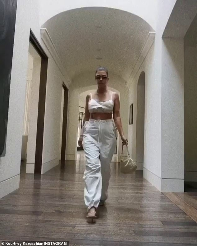 Strut: Kourtney included a stop-motion style video of her strutting down the hallway of her house in her edgy cut and a pair of dark tinted sunglasses