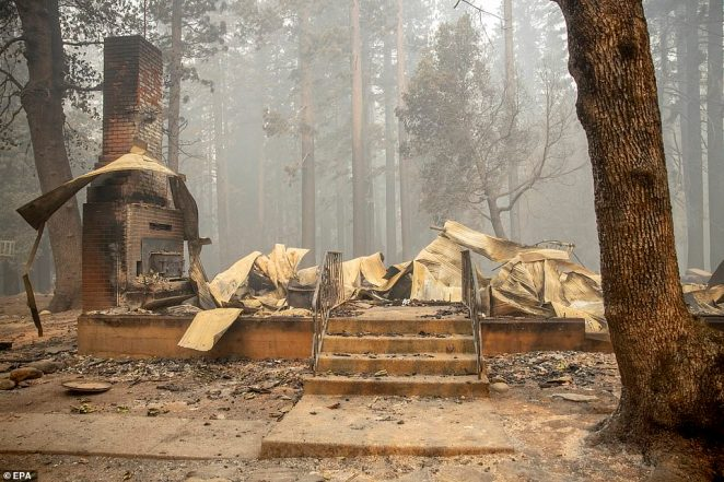 The remains of a US Forestry Department building after it was destroyed by the Bear Fire in Berry Creek, California, are pictured on Saturday