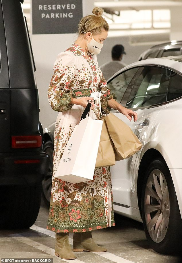 Bohemian babe: For her shopping trip, Hudson slipped her fit physique into a Bohemian maxi dress that was riddled with stunning floral details