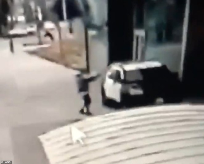 Video released by the Los Angeles Sheriff's Department shows the moment that male suspect opened fire on two deputies at a Compton bus station