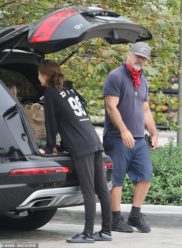 Family man: Mel Gibson, 64, looked rugged in a polo shirt with a popped collar as he made a grocery run in Malibu on Saturday with his younger girlfriend Rosalind Ross, 30, and their son Lars, three
